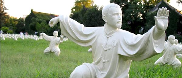 Sculptures of people performing Tai Chi are displayed at Peking University