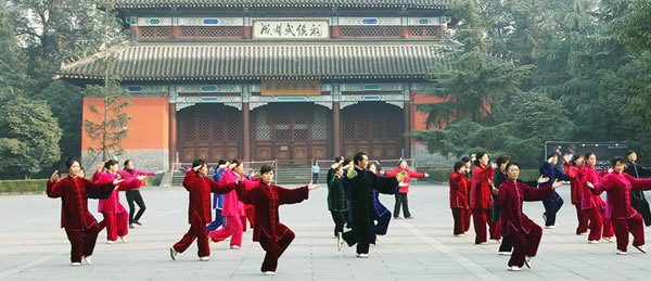 Tai Chi students practicing in front of a temple in China.